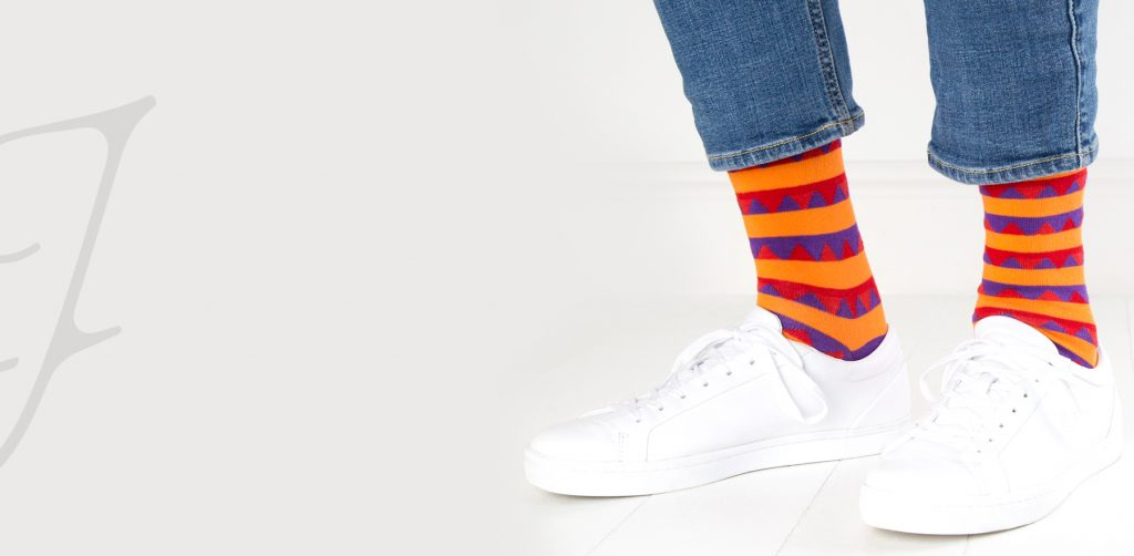 close up of person wearing multi coloured patterned socks