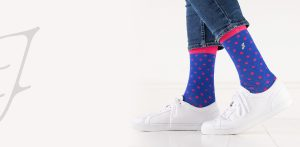 close up of person wearing blue socks with pink dots