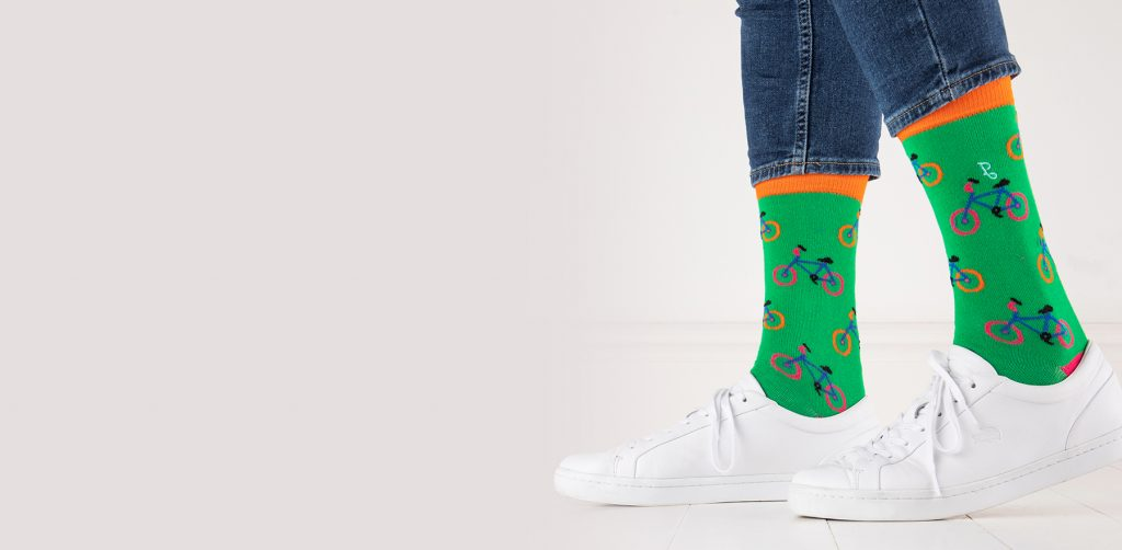 close up of person wearing green sock with bicycle pattern