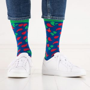 close up of person wearing red, green and blue patterned socks
