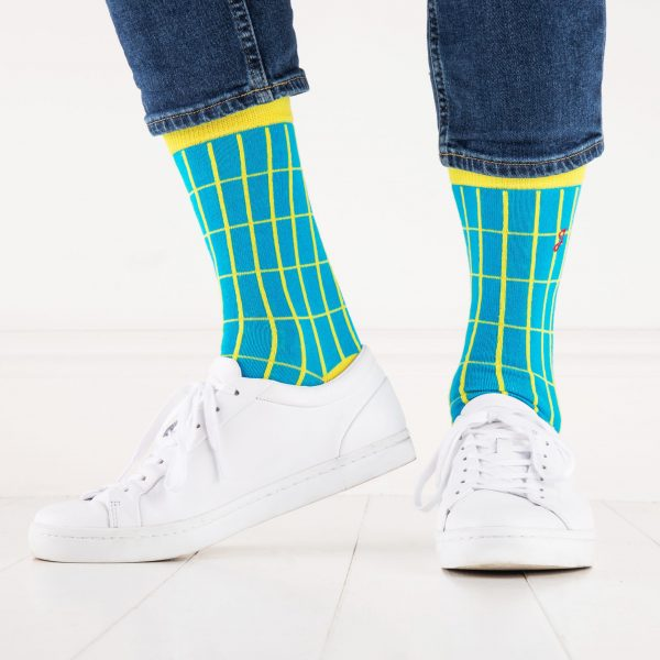 close up of person wearing yellow and blue patterned socks