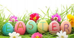 6 decorated eggs for easter in grass