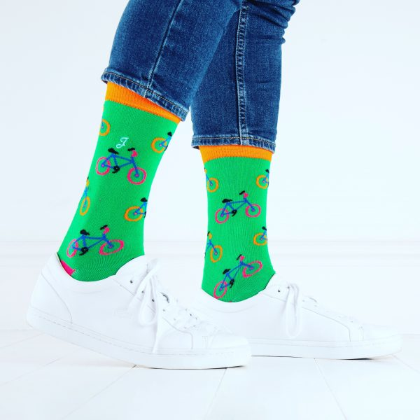 close up of person wearing green socks with bicycle pattern