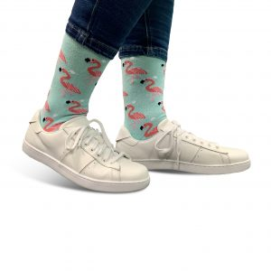 close up of person wearing flamingo patterned socks