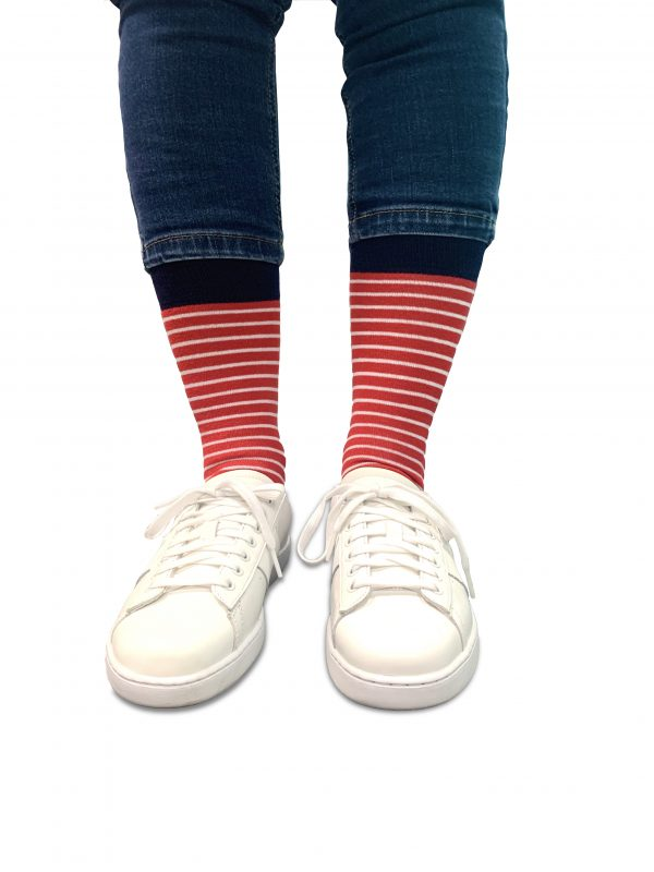 close up of person wearing red and white striped socks